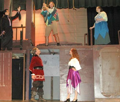 Frollo (Raul Jalmasco), top left, and Florika (Melissa Kloempken), top right, want�Quasimodo (Dave Stepan), top center, to stop ringing the cathedral�bells during a dress rehearsal for Stewartville Community Theatre's upcoming presentation of
