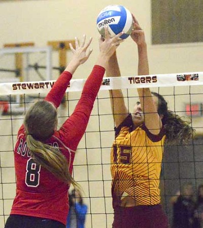 Kaitlyn Prondzinski uses two hands to win this block against JM.