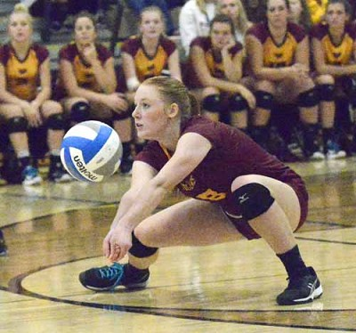 Tiger libero Emily Rinken gets low on this dig of a KoMet attack during Stewie�s 3-0 win.