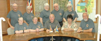 Mayor Jimmie-John King, seated in center, signed a proclamation last week declaring Saturday, Oct. 7 White Cane Day in the city of Stewartville. On that day, members of the Stewartville Morning Lions Club will collect donations to help restore the gift of sight to individuals with vision problems. Morning Lions Club members who will assist with the project include, front row, from left, Sharon Bernard, Kay Tvedt, event chair; Sharon McAtee and Dave Hoot. Back row, from left, Gene Bernard, Karen Freiheit, Carol Cole, Lucien Cole and Del Jahns. The mayor�s proclamation also declares that Lions Clubs International, with more than 1,300,000 members in the free world, has been dedicated to serving sight for more than 60 years.