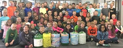 Fourth graders at Bear Cave Intermediate School, led by teacher Lynn Bussan, researched hurricanes for a science project and raised funds to help an elementary school in Texas recently damaged by Hurricane Harvey. The students raised $1,116.39, which was sent to Gilbert J. Mircovich Elementary School in Ingleside, Texas, a building badly damaged by the hurricane.