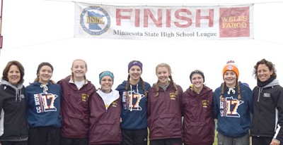 In its first-ever state tournament appearance as a team, the Stewartville girls captured fourth place at the MSHSL Class A Girls Cross Country State Championships at   St. Olaf College in Northfield on Nov. 4. Tiger team members are, from left, Head Coach Mickie Tuseth, Gracie Waltman, Isabel Field, Abby Orvis, Laura Pedelty, Gloria Nelson, Kailee Malone, Olivia Field, and Assistant Coach Dawn Miller.