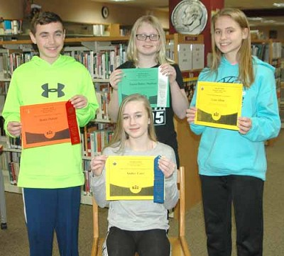 The top four place winners in the Stewartville Middle School spelling bee include, clockwise from front, Amber Carr, first place; Brady Pickett, second place; Emma-Bailey Mullinix, third place; and Grace Elton, fourth place. The top four finishers will move on to compete at the bee at the Southeast Service Cooperative on Tuesday, Feb. 13.