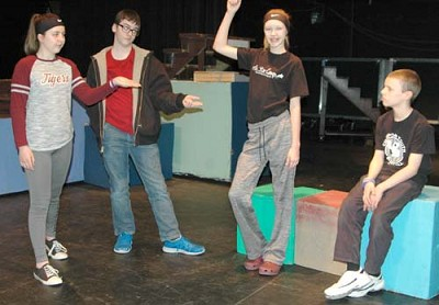 Doug�s parents, played by, from left, Angela McClellan and Jayden Powell, tell Doug (Ted Skare), far right, to go out and play with Susie (Rylee Johnson), second from right, during a rehearsal for the Stewartville Middle School production of 23 Reasons Not To Be In A Play, set to debut at the Performing Arts Center this Friday, Feb. 16 at 7 p.m.  Much to Doug�s dismay, Susie, the only other kid in the neighborhood, insists on being a fairy every time she is part of a play.