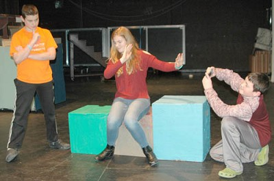 Tom (Jacob Ramp), left, explains how Jess (Olivia Field), center, and her dad�s (Jacob Schimek), right, relationship comes to a breaking point during a rehearsal for the Stewartville Middle School production of 23 Reasons Not To Be In A Play. set to debut at the Stewartville High School Performing Arts Center this Friday, Feb. 16 at 7 p.m. Jess�s dad�s camera obsession becomes disastrous when he learns Jess has been cast in the school play.