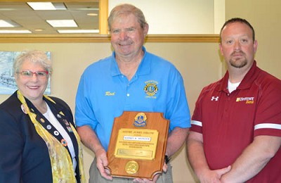 Rod Morlock, center, accepts the Stewartville Lions Club�s Melvin Jones Fellowship Award for 2018-19 from Nadeen Lunde, district governor, left, and Mike Rainey, incoming Stewartville Lions Club president.