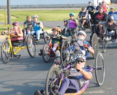 Participants at the National Wheelchair Sports Camp at Ironwood Springs Christian Ranch get off to a good start in the annual Wheels and Heels of Fire 10K event on Sunday morning, June 9.