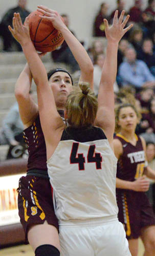 Lily Welch attacks the rim for two of her 24 points against Cannon Falls.