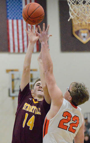 Eli Klavetter goes up and over a Lake City defender for a floating jumper in the lane.