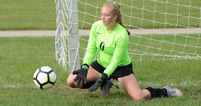 Goalkeeper Ava Myhre hustles to the post to make a scoop save.