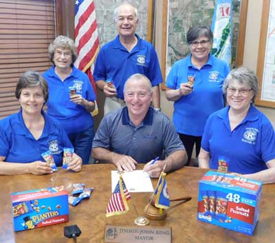Mayor Jimmie-John King has signed a proclamation declaring the observance of Peanut Days in the city of Stewartville. Kiwanis Club members who will collect donations for the project include, from left, Rita Oswald, Margaret Clark, Don Brouillard, Glynis Strum and Mary Brouillard.